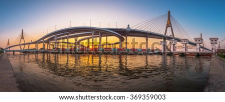 "Beautiful panorama of the Bhumibol Bridge before sunset, Bangkok, Samut Prakan, Thailand. Foreign text on the bridge is the bridge name ""Bhumibol 1""."