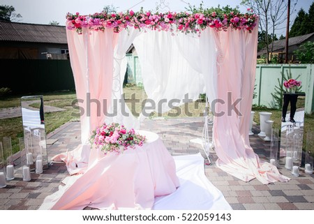 beautiful pink and white arch for wedding ceremony