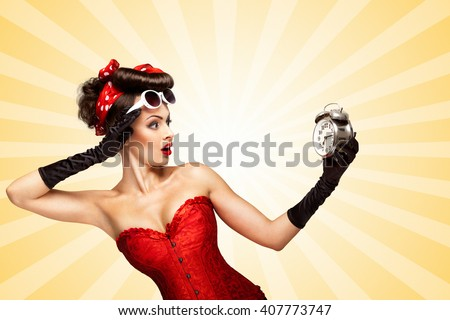 Beautiful pinup girl in a red vintage corset being late in the morning and holding a retro alarm clock in her hand on colorful abstract cartoon style background.