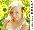 Beautiful portrait of summer young girl in the field of sunflowers - stock photo