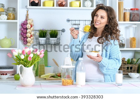 beautiful pregnant woman with  milk