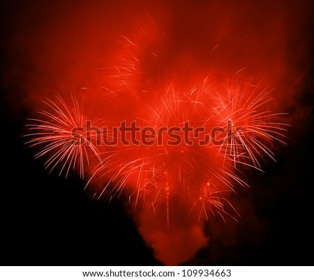 Beautiful red fireworks in the night sky