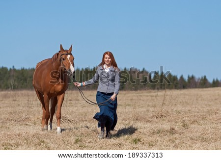 Beautiful red haired girl and Russian Don horse