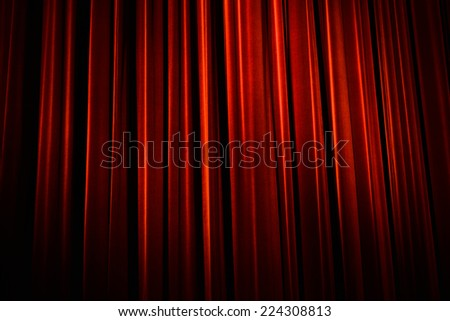 Beautiful red theater curtain with dark shadows