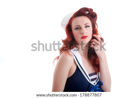Beautiful retro pin-up girl in a sailor style dress
