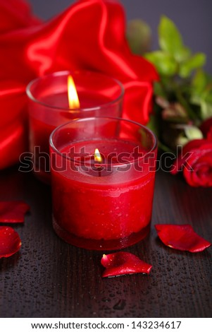 Beautiful romantic red candle with flowers, close up