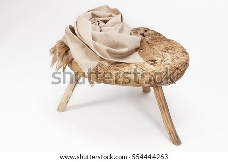 Beautiful scarf on old stool , scarf top view.