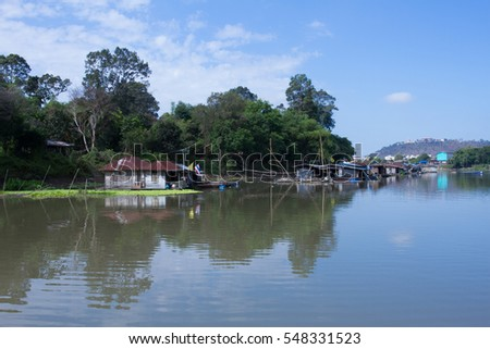 Beautiful scenery of the Thai floating house along the river in Uthaithani, Thailand