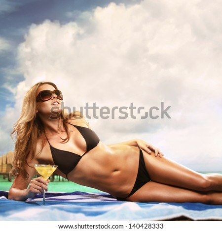 Beautiful Sexy Blond Woman Drinking Cocktail By The Sea - stock photo