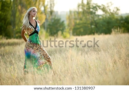 Beautiful sexy blonde girl posing in the grass
