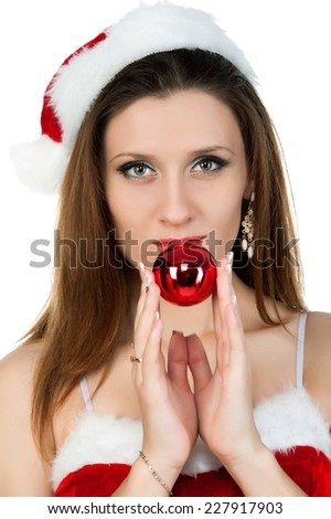 Beautiful sexy brunette girl in a Christmas costume, posing on a white background isolated