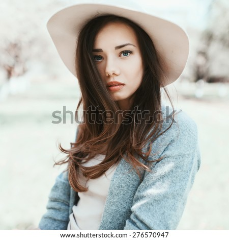 Beautiful sexy girl with a hat posing at the camera