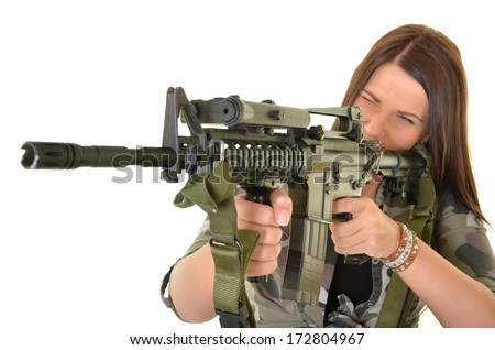 Beautiful sexy woman posing with a gun over white background