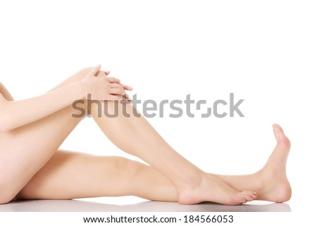 Beautiful shaved woman's legs. Isolated on white.