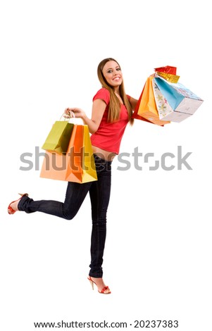 Beautiful shopping girl with colorful bags.