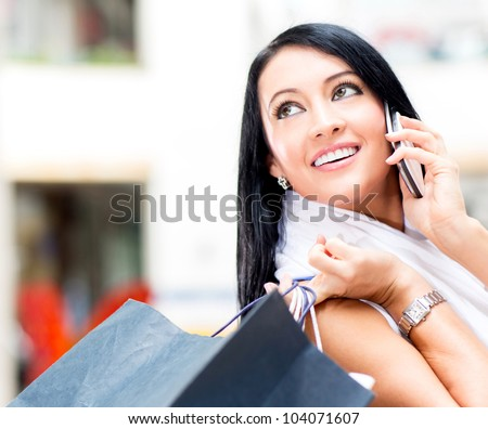 Beautiful shopping woman talking on the phone