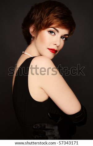 Beautiful slim redhead woman with stylish make-up and hair-cut