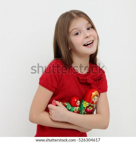 Beautiful teen girl holding matryoshka stock photo for Beautiful small teen