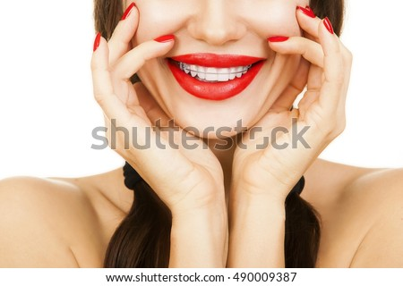 Beautiful smiling girl with retainer for teeth, and with red lipstick. Orthodontics Dental Theme, Methods of Teeth (Bite) Correction, Close-up