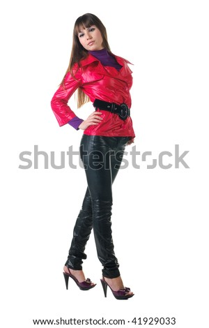 beautiful smiling woman in leather pants. Isolated over white background .
