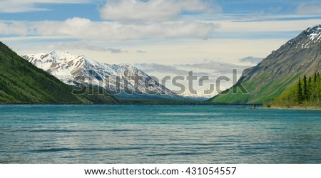 Beautiful snow covered Yukon mountains and crystal lake