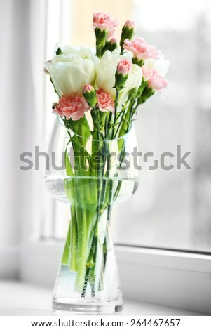 Beautiful spring flowers on windowsill background