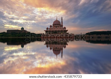 Beautiful sunrise reflections of Putra Mosque in Putrajaya, Malaysia. Nature composition.