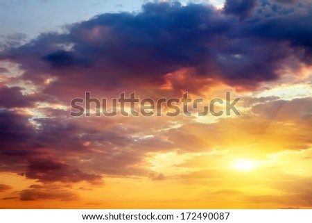 Beautiful sunset sky with sun. Sky background.