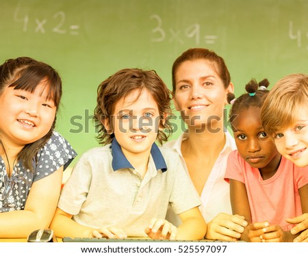 Beautiful teacher with mixed race classroom.