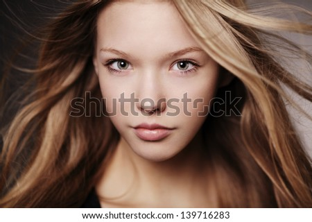 beautiful teen girl portrait with windy hair