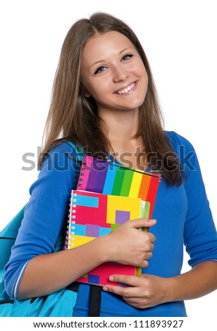 Beautiful teen girl with exercise books posing on white background