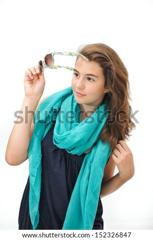 Of blond teen holding sunglasses bush and