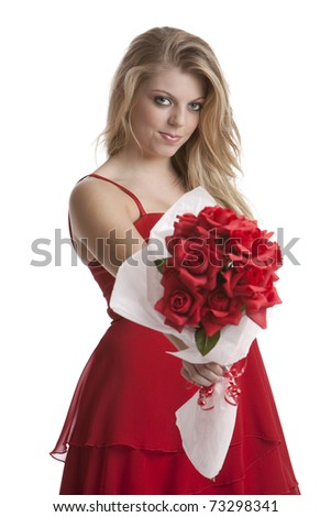 Beautiful teenage girl in a red dress holding a bouquet of roses isolated on white background