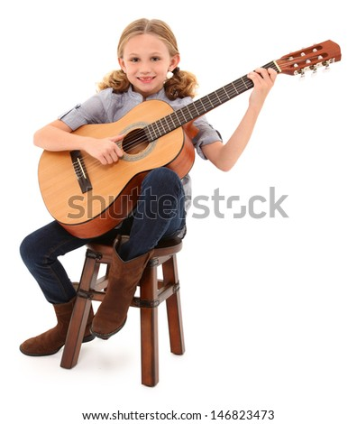 Beautiful ten year old with acoustic guitar over white with clipping path.