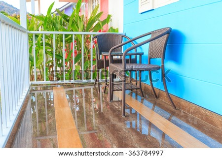 Beautiful terrace or balcony with small table, chair and flowers. Vintage image