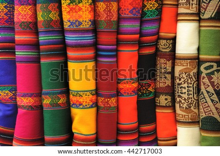 Beautiful traditional blankets displayed in a Peruvian market