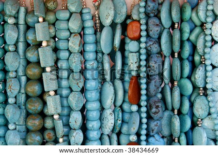 Beautiful turquoise gemstone necklaces on display on the market