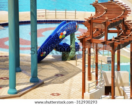 Beautiful view of blue swimming pool and slides