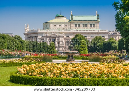 Beautiful view of famous Volksgarten (People's Garden) public park with historic Burgtheater in the background on a sunny day with blue sky in summer, Innere Stadt first district of Vienna, Austria