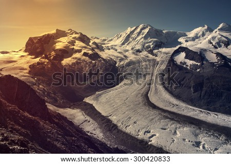 Beautiful view of idyllic summer landscape in the Alps with Gornergrat glacier and most famous peaks of Monte Rosa in Swiss Alps