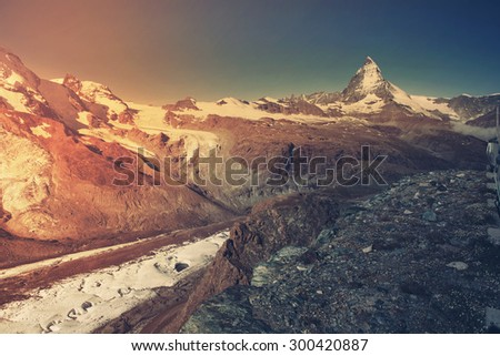 Beautiful view of idyllic summer landscape in the Alps with Gornergrat glacier and most famous peak - Matterhorn