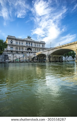 Beautiful view on historical landmark of Corte di Cassazione, Palace of justice, stone bridge through Tiberis or Tevere river in Italy, Rome, vertical picture