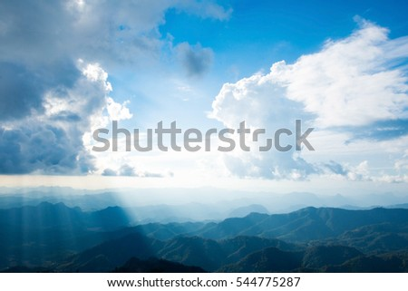 beautiful view on mountain with blue sky and dark cloud. subject is blurred and low key