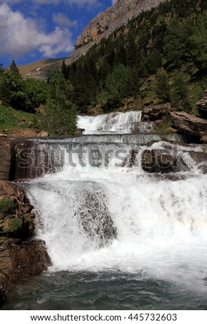 Beautiful waterfall along the zone called Gradas de Soaso in Ordesa National Park in the Pyrenees.