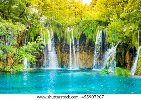 Beautiful waterfall landscape. Scenic cascade with lake and forest for travel, outdoor activity and spring, summer, autumn vacation.