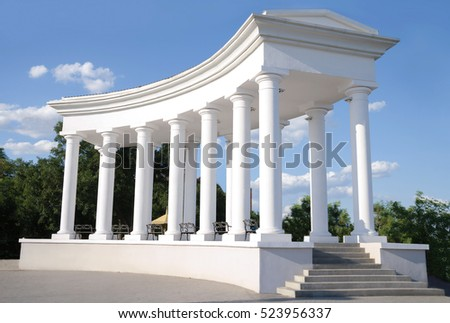 beautiful white columns at the main entrance to the park in the city Chernomorsk in Ukraine