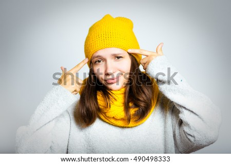 beautiful winter girl pointing finger on the brain, isolated close-up