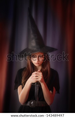 beautiful witch with knife