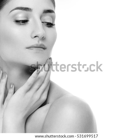 Beautiful Woman Face Portrait Beauty Skin Care Concept. Fashion Beauty Model isolated black and white