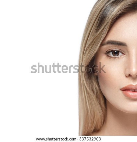 Beautiful woman half-face portrait close up studio on white blonde
